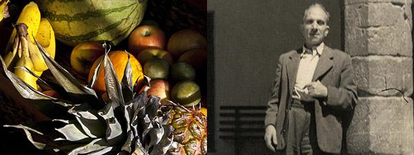 Una cesta de frutas junto a una imagen del poeta Carles Salvador.